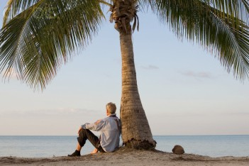 Businessman on Deserted Island --- Image by © Paul Barton/Corbis